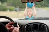 driver distracted by cell phone about to hit a child